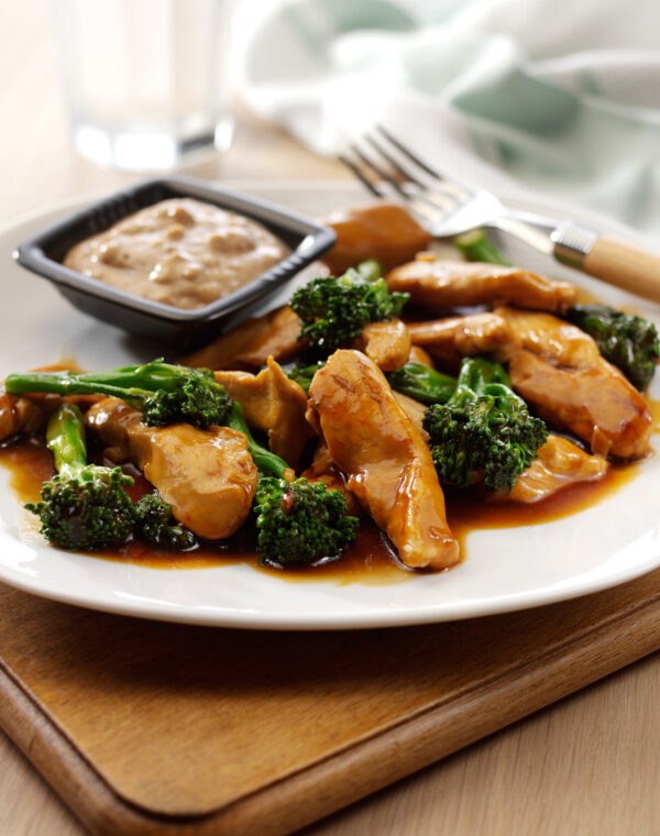 The Body Coach's Garlic and Teriyaki Chicken served with Bimi® broccoli and Peanut Butter Dip