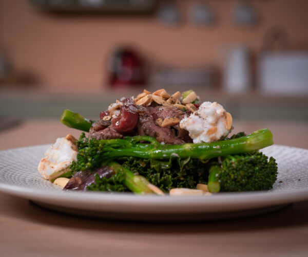 Tenderstem® broccoli and Australian Flank Beef with caramelized onion, goat cheese and roasted pepper and crushed Almond by Chef Tarek