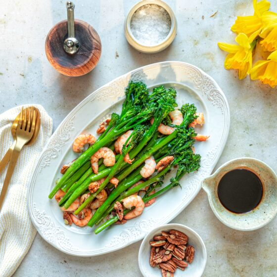 Garlic sautéed Tenderstem® broccoli and prawn salad, with a salted maple dressing and pecans