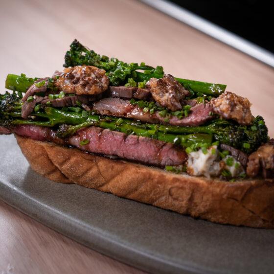 Roasted Tenderstem® broccoli, Gorgonzola, caramelized walnuts and flank strips by Chef Tarek